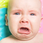 Как успокоить грудного ребенка